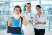Insured injured woman — Stock Photo