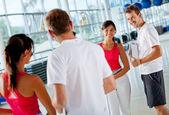 Gym woman with her trainer — Zdjęcie stockowe