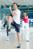 Gym group exercising — Foto Stock