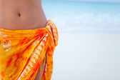 Beach woman wearing a sarong — Stock Photo