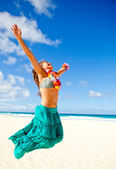 Jumping at the beach — Stock Photo