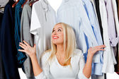 Woman in a wardrobe — Stock Photo