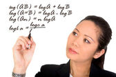 Asian girl solving a mathematical formula — Stock Photo