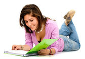 Female student reading a notebook — Stock Photo