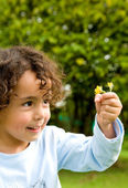 Child with a flower — Stock Photo