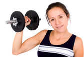 Girl lifting freeweights — Stock Photo