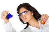 Chemist with test tubes — Stock Photo