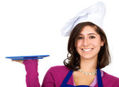 Female chef with a plate — Stock Photo
