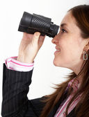 Business woman with binoculars — Stock Photo