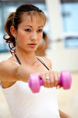 Woman doing freeweights — Stock Photo