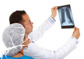 Doctors checking an x-ray — Stock Photo