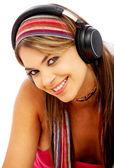 Woman listening to music — Stockfoto