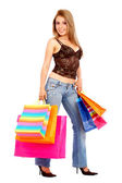 Woman with shopping bags smiling — Stock Photo