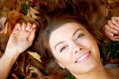 Beautiful autumn woman portrait smiling — Stock Photo
