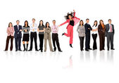 Business team - woman standing out — Stok fotoğraf