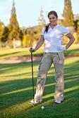 Female golf player — ストック写真