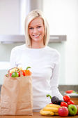 Woman with groceries — Stock Photo