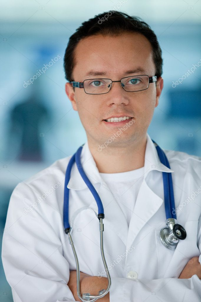 Friendly male doctor smiling at the hospital — Stock Photo #7762448