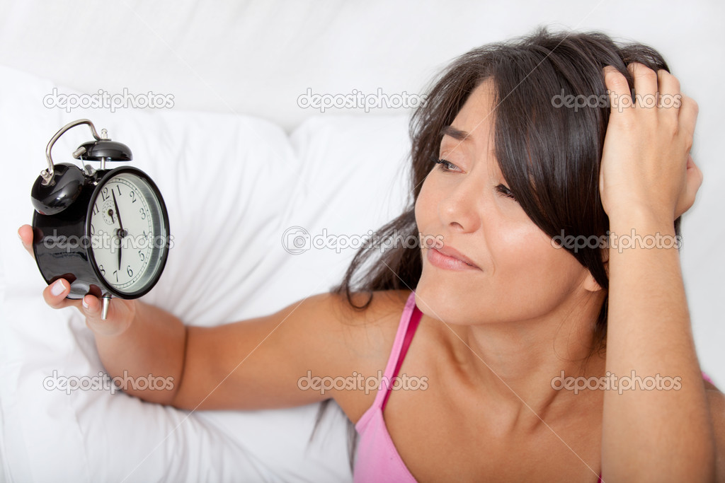 Woman waking up and running late looking at the alarm clock — Stock Photo #7764107