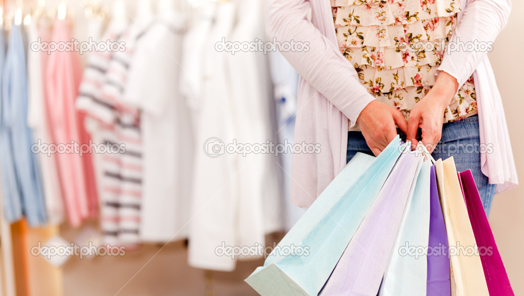 Unrecognizable woman in a store holding shopping bags  Stock Photo #7764669