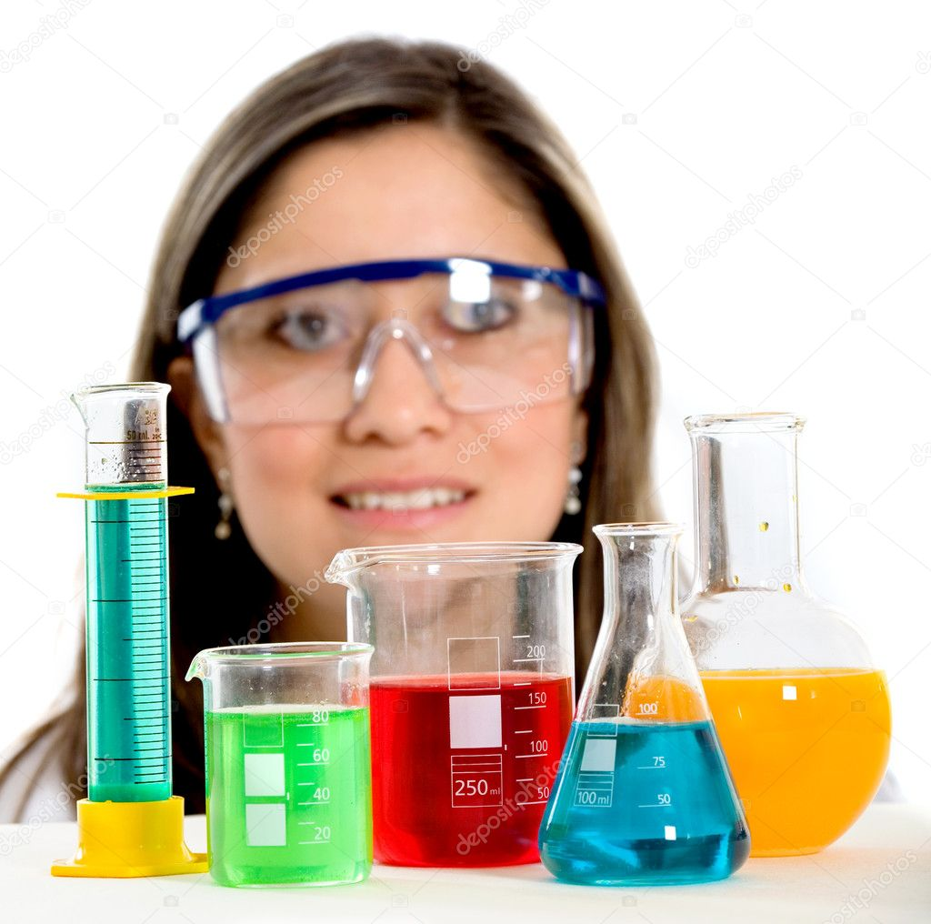 Beautiful female science student with test tubes in front of her — Stock Photo #7764893