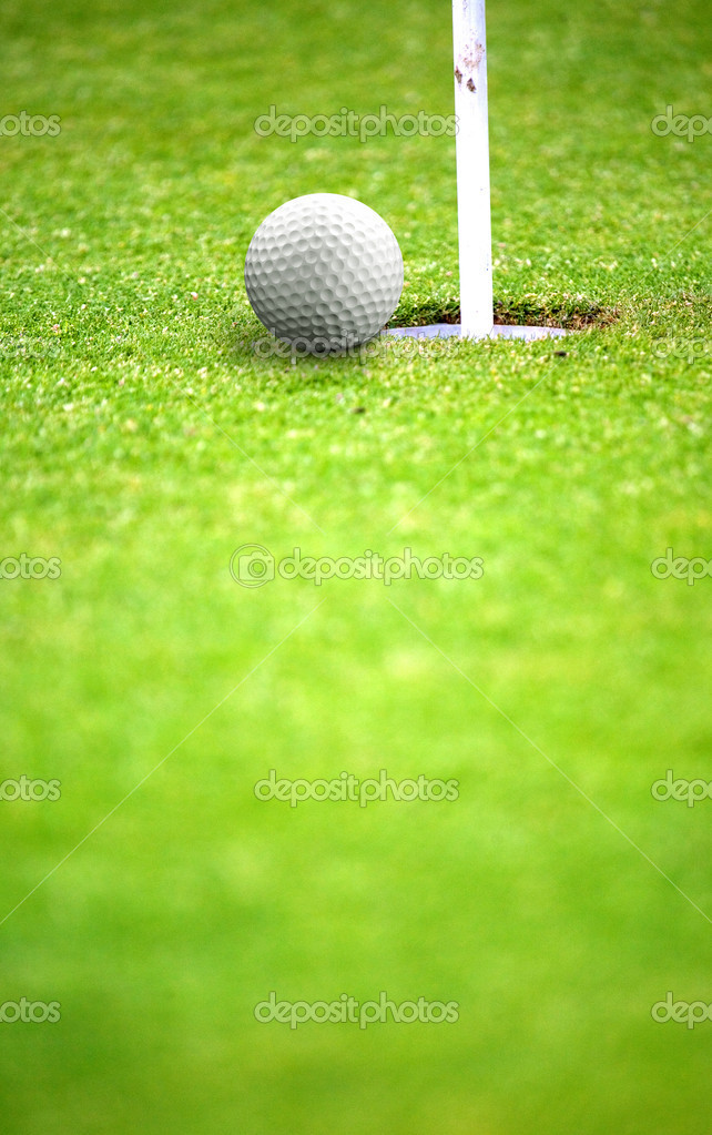 Golf ball very near a flag hole — Stock Photo #7765399