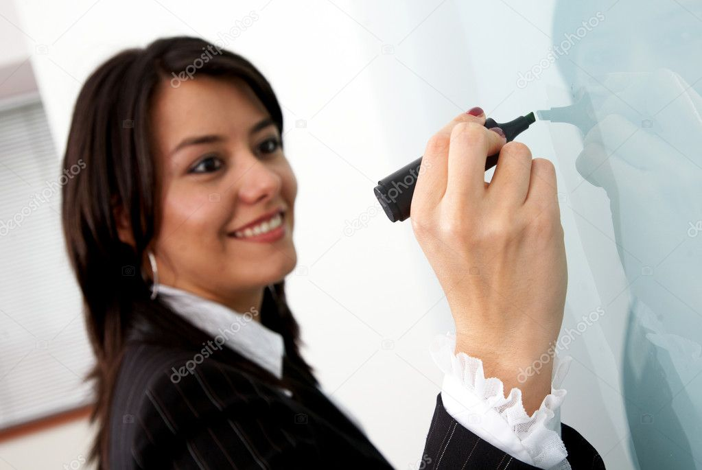 Business woman writing on a screen in an office — Stock Photo #7766327
