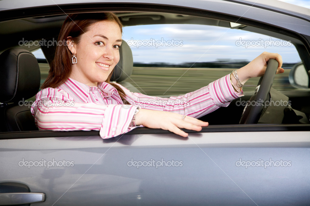 Business woman smiling and driving a brand new car — Stock Photo #7766784