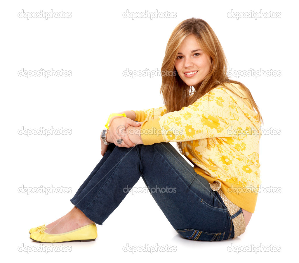 Blond girl smiling on the floor isolated over a white background  Stock Photo #7767165