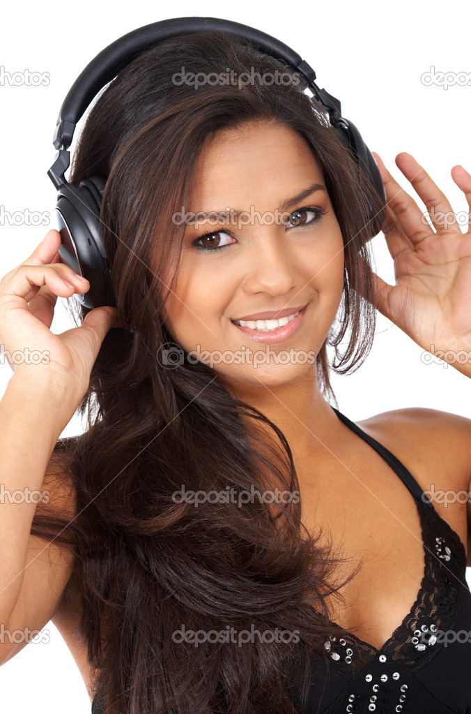 Black girl listening to music looking happy isolated over white — Stock Photo #7767282