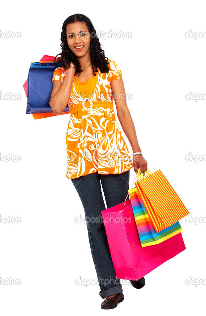 Casual woman walking with shopping bags isolated over a white background — Stock Photo #7768174