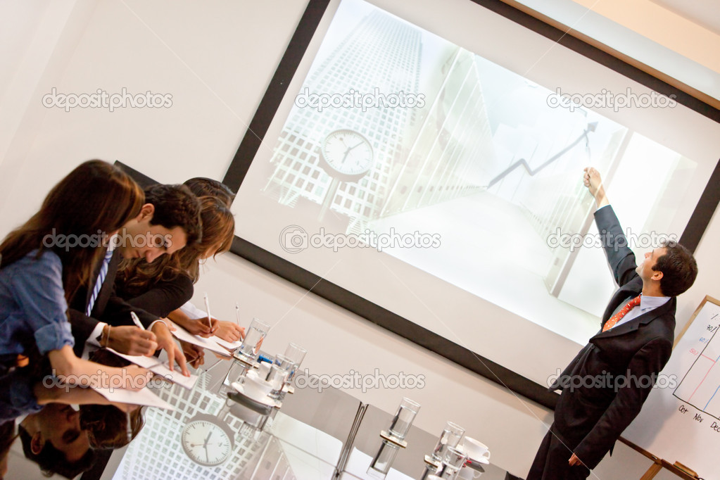 Business man making a presentation at the office — Stock Photo #7769653