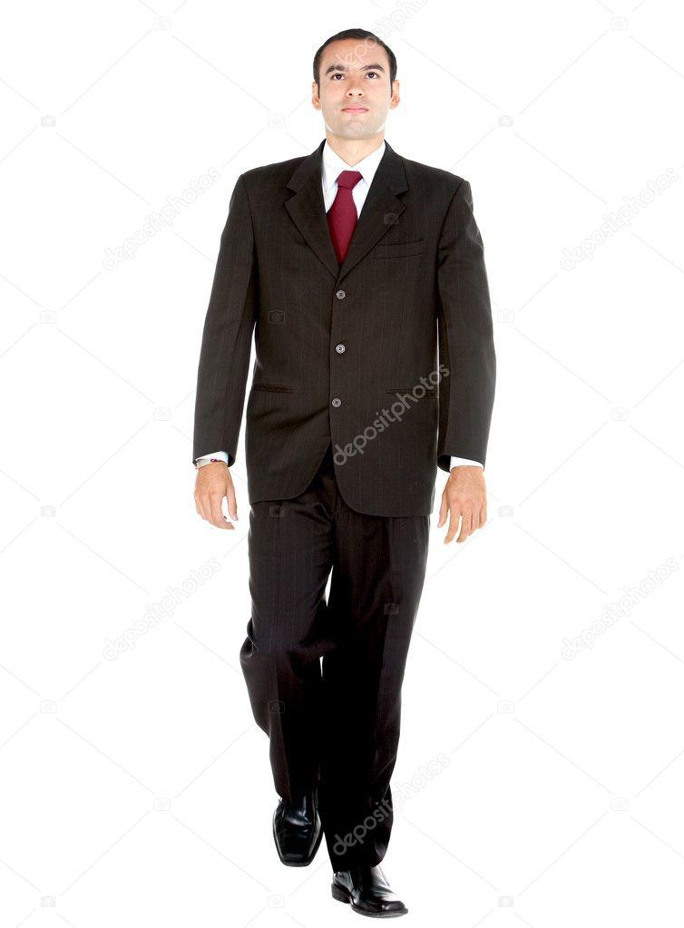 穿西装走-孤立在白色背景的优雅的商务人