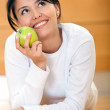 Pensive woman with an apple — Stock Photo