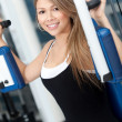 Royalty-Free Stock Photo: Woman at the gym exercising