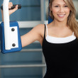 Woman at the gym exercising — Stock Photo #7770386