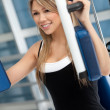 Woman at the gym exercising — Stock Photo #7770387