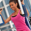 Woman at the gym exercising — Stock Photo #7770389
