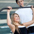 Gym woman and trainer — Stock Photo