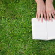Reading a book outdoors — Stock Photo #7770442