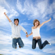 Couple jumping outdoors — Stock Photo