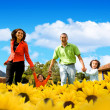 Stock Photo: Family in a field of sunflowers