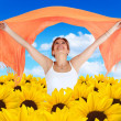 Woman in a field of sunflowers — Stock Photo