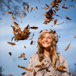 Autumn woman with leaves falling — Stock Photo