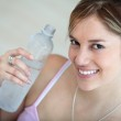 Woman wit a bottle of water — Stock Photo #7770754