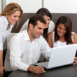 Business group with laptop — Stock Photo #7770775