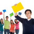 Happy student with a group — Stock Photo