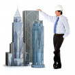 Engineer leaning on buildings — Stock Photo