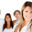Woman smiling with a group — Stock Photo