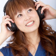 Asian woman with headphones — Stock Photo